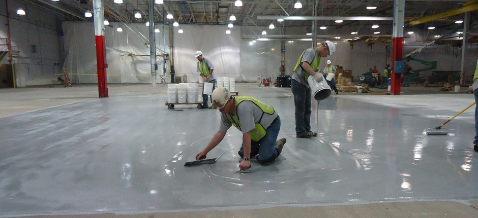 Our crew at work adding a new floor coating